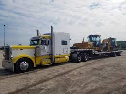 100 Step Deck Truck Trailer Hauling By Heavy Haulers