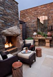 Inexpensive Patio Floor Ideas by Baroque Arched Mirror In Patio Contemporary With Rock Fireplace