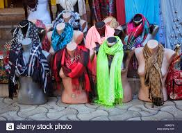 mannequins wearing scarves on a sidewalk of a turkish town stock