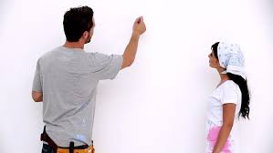 Attractive Man Painting A Heart Onto White Wall For His Girlfriend Stock Footage Video 4114249