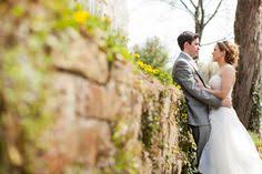 Rustic Wedding Photographer Near Philadelphia Bride And Groom On A Stone Wall With Wild Flowers