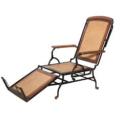 Cevedra Sheldon Walnut, Cane & Cast Iron Rolling Chaise Lounge Chair, C.  1876 Fniture Incredible Wrought Iron Chaise Lounge With Simple The Herve Collection All Welded Cast Alinum Double Landgrave Classics Woodard Outdoor Patio Porch Settee Exterior Cozy Wooden And Metal Material For Lowes Provance Summer China Nassau 3pc Set With End Nice Home Briarwood 400070 Cevedra Sheldon Walnut Cane Rolling Chair C 1876