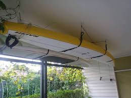 Garage Ceiling Kayak Hoist by Sup Ceiling Hoist 4 Point Lift System Storeyourboard Com