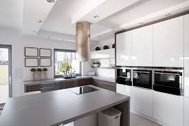 Modern Kitchen With White Cabinets Black Appliances And Gray Counter Island