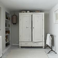 White Bedroom With Distressed French Style Wardrobe And Storage