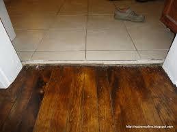 transition between hardwood and tile floor mud room threshold