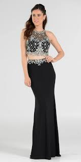 two piece black prom gown with embellished crop top and ity skirt