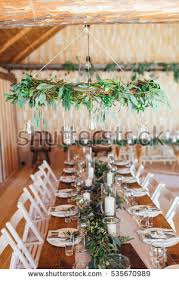 Rustic Wedding Decor Wreath Chandelier Decorated With Eucalyptus And Table