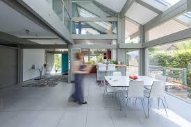 100 Contemporary Housing Housing With Woman Walking Towards The Kitchen