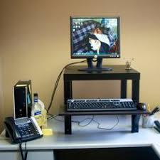 Kangaroo Standing Desk Imac by Mymac Kangaroo Adjustable Height Desk Supporting A 21