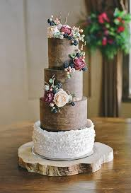 A Chocolate Ganache Rustic Wedding Cake With White Ruffled Frosting And Cascading Sugared Flowers