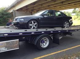 Audi's On Tow Truck Beds All Around! : Audi