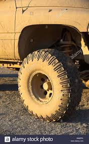 100 Front Wheel Drive Trucks Wheel Tire Of A Muddy 4WD Pickup Truck Four Wheel Drive Stock