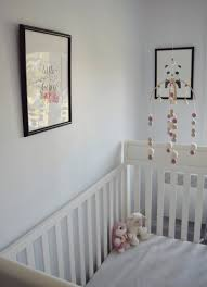 elephant theme baby nursery with cribs and grey walls