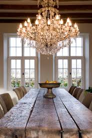 Chandelier Over Dining Room Table by Farmhouse Dining Room Table And A Dramatic Elegant Chandelier Over