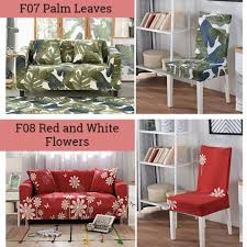 Palm Leaves , Red And White Flowers Sofa And Chair Cover ... 10 Red Couch Living Room Ideas 20 The Instant Impact Sissi Chair Palm Leaves And White Flowers Sofa Cover Two Burgundy Armchairs Placed In Grey Living Room Interior Home Designing A Design Guide With 3 Examples Jeremy Langmeads English Country Home For The Digital Age Brilliant Accessory Licious Image Glj Folding Lunch Break Back Summer Cool Sleep Ikeas Memphisinspired Vintage Collection Is Here Amazoncom Zuri Fniture Chaise Accent Chairs White Kitchen Stock Photo