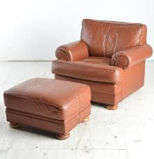 Vintage Brown Leather Armchair With Ottoman : EBTH Retro Brown Leather Armchair Near Blue Stock Photo 546590977 Vintage Armchairs Indigo Fniture Chesterfield Tufted Scdinavian Tub Chair Antique Desk Style Read On 27 Wide Club Arm Chair Vintage Brown Cigar Italian Leather Danish And Ottoman At 1stdibs Pair Of Art Deco Buffalo Club Chairs Soho Home Wingback Wingback Chairs Louis Xvstyle For Sale For Sale Pamono Black French Faux Set 2