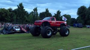 100 Red Monster Truck Crushes Cars At Extreme Stunt Show YouTube