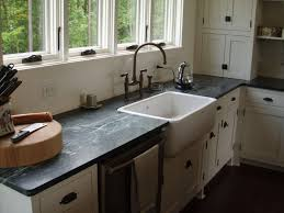 traditional style kitchens with ranch style apron sinks black