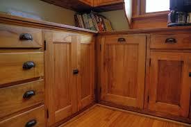 Craftsman Kitchen with Hardwood floors & Wood cabinets in Saint