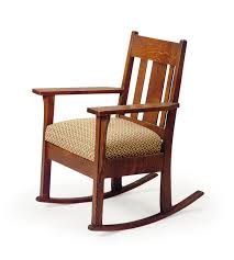 AN AMERICAN ARTS & CRAFTS OAK ROCKING CHAIR, | EARLY 20TH ...