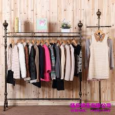 Young Wrought Iron Clothing Rack Store Display Racks For Within Awesome Clothes