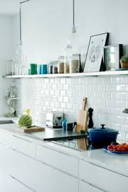 simple clean white kitchen and butcher block countertops home