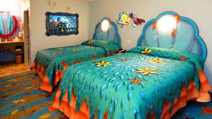 calming brown bedroom shows double turquoise trippy bedding set
