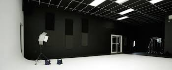 large production studio space with green white cyc walls