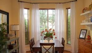 adding floor length curtains to any window creates instant polish