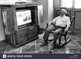 Old Man In Rocking Chair Stock Photos & Old Man In Rocking Chair ... Old Man Sitting In Rocking Chair And Newspaper Vector Image Vertical View Of An Old Cuban On His Veranda A A Young Is Theory Fact Ew Howe Kursi Man Rocking Chair Watching Tv Stock Royalty Free Clipart Image Collection Hickory Porch For Sale At 1stdibs Drawing Getdrawingscom For Personal Use Clipart In Art More Images The Who Falls Asleep At By Ahmet Kamil Kele Rocking Chair Genuine Old Antique Farnworth
