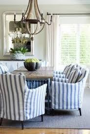 Coastal Dining Room With Reclaimed Wood Chandelier And Blue White Striped Slipcovered Chairs Via Roses Rust By Hercio Dias