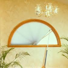 Arched Or Curved Window Curtain Rod Canada by Large Arched Window Treatment Idea With Floral Curtain With Topper