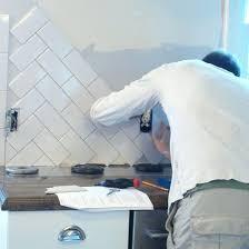 travertine tile backsplash installation wall cabinets