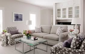 light gray roll arm sofa with purple trellis pillows