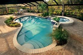 Double Pool With Brick Stone Deck Also Green Plant Plus Stone ... Decorating Attractive Above Ground Pool Deck For Enjoyable Home Good Picture Of Backyard Landscaping Decoration Using White Latest Ideas On Design Inspiring And 40 Uniquely Awesome Pools With Decks Pools Beautiful Oval Designs Gardens Geek Modern Image Solid Above Ground Pool Landscaping Ideas Swimming Spa Best And Emerson