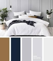 dunkelblaue und goldene tapete bettdecke bett möbel