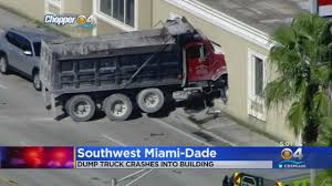 100 Southwest Truck And Trailer Dump Ends Careening Into SW Dade Insurance Building
