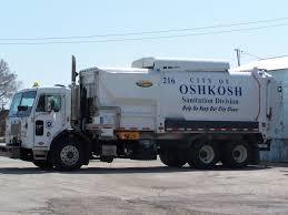 100 Truck Central An Oshkosh Garbage Truck Sits Parked At Garage Public