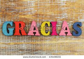 Gracias Which Means Thank You In Spanish Written With Colorful Letters On Rustic Wooden