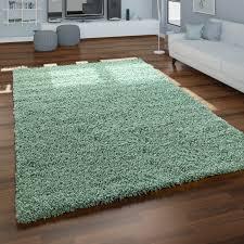 teppich wohnzimmer hochflor schlichtes einfarbiges design modern unifarben grün