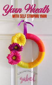 Make a DIY spring or summer yarn wreath with fun self striping yarn