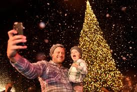 David And Max Toney Take A Selfie In Front Of The Christmas Tree As Snow Falls Upon Fashion Island During Lighting Ceremony Newport Beach