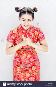 asian chinese in red qipao cheongsam suite point to camera potrait