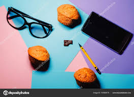 Three Cupcakes Baking Confectionery Phone Communication Glasses Sight Office Workplace Stock Photo