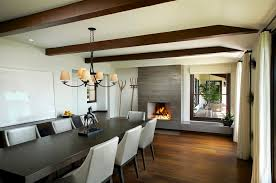 Southern California With Chandelier Dark Dining Table Gray Chair Fireplace Ledge Interior Iron Mid Cen
