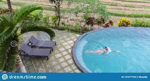 100 Infinity Swimming Luxury Resort Man Relaxing In Pool Water