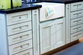 White Kitchen Cabinet Design And Cabinets Handles Placement With Black Marble Countertop
