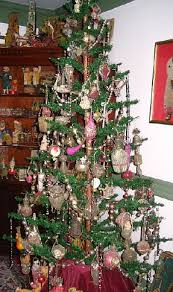 Six Foot German Feather Tree Decorated With 1881 1920 Wire Wrapped Ornaments Antique Toys In 1800 Cupboard