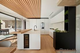 this combined kitchen and dining room is defined by an